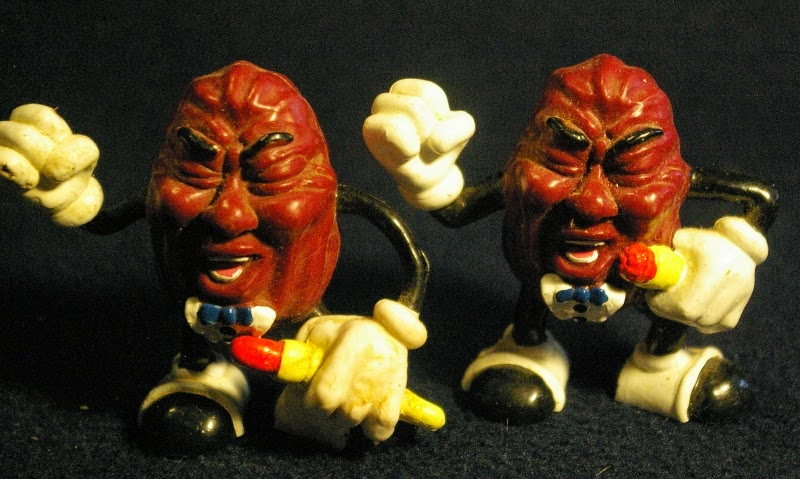 i have two similar but slightly different lead singer figures im not sure if they are truly different or if the microphone arm on the one is wrapped - California Raisin Halloween Costume