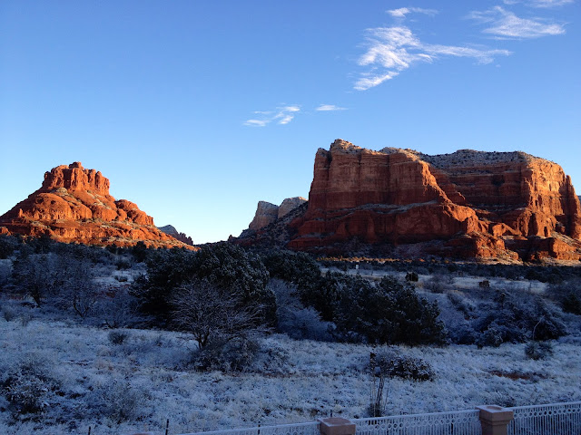 Early morning view of Bell Rock and Courthouse Butte in snow