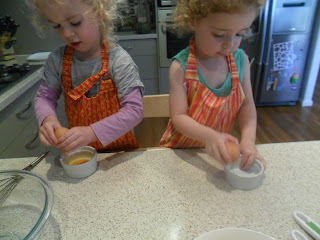 Young girls cracking eggs for french toast kebabs recipe