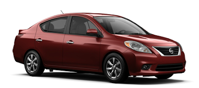 2013 Nissan Versa sedan red brick