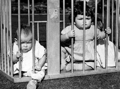 imprison children in a cage