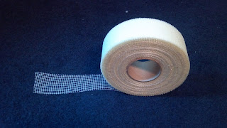 a roll of fiberglass dry wall joint tape