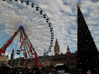 Christmas time in Lille, France with big wheel and Christmas tree