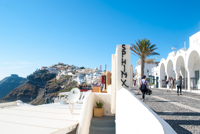 White walls and streets, sphinx Fira, Santorini, Greece