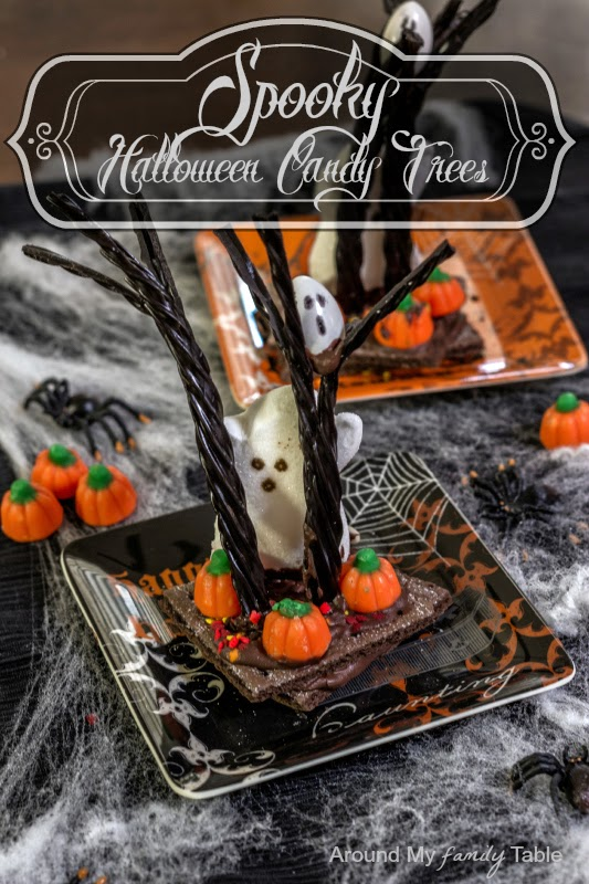 http://www.aroundmyfamilytable.com/2013/10/spooky-halloween-candy-trees/