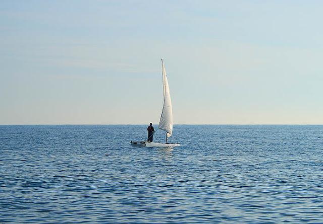 Man on a catamaran