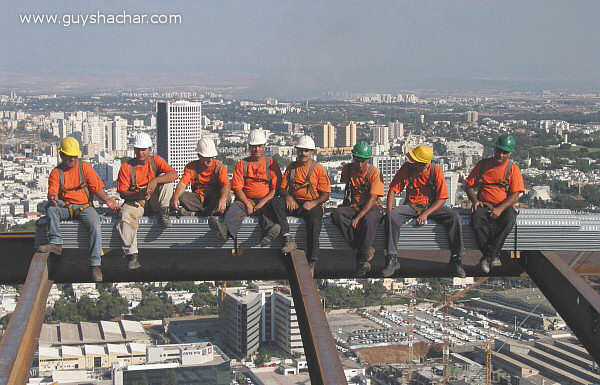Construction workers and steel beams on the skyscraper in Tel Aviv