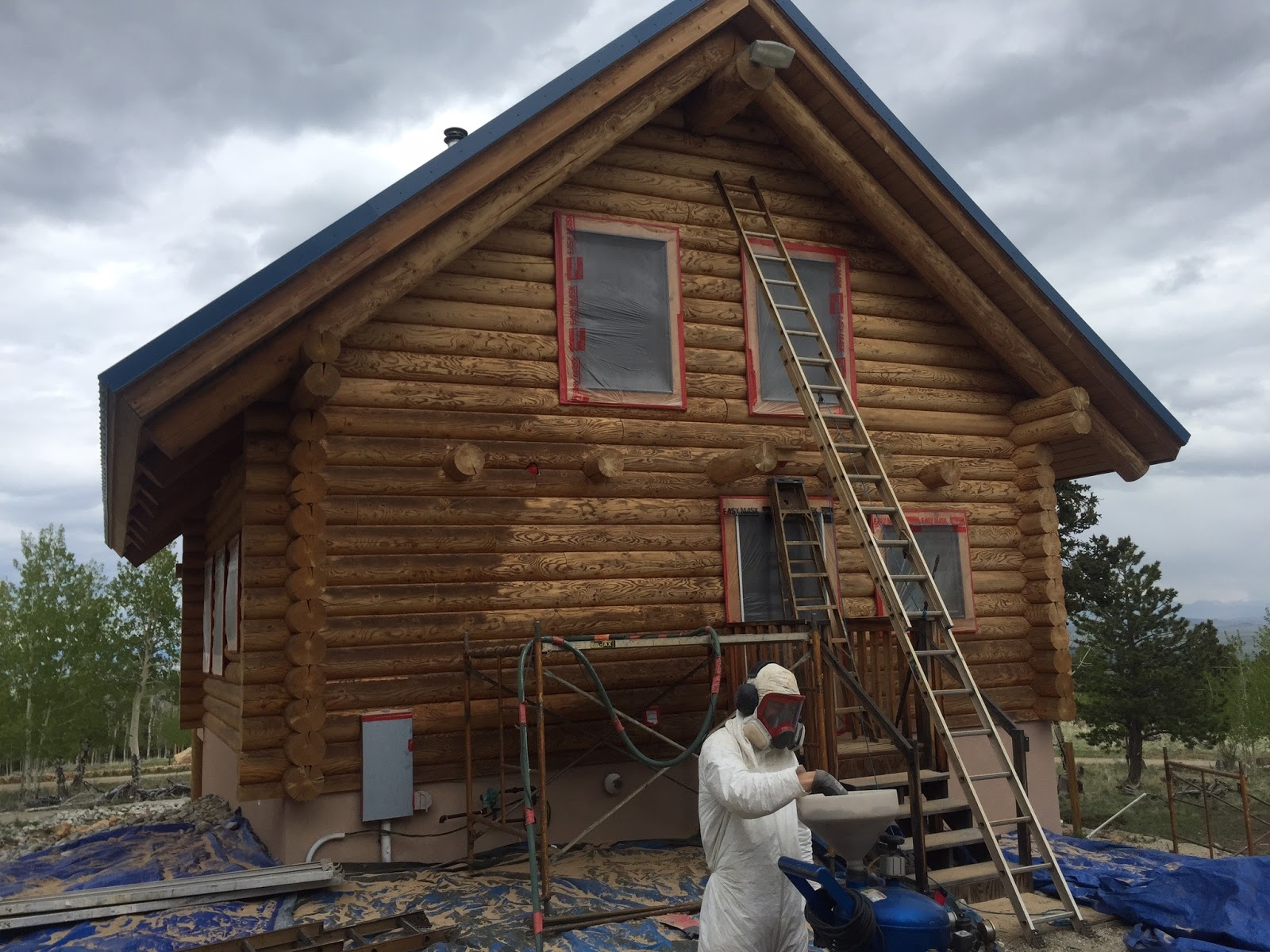 Log home repair blog log home maintenance for How to stain log cabin