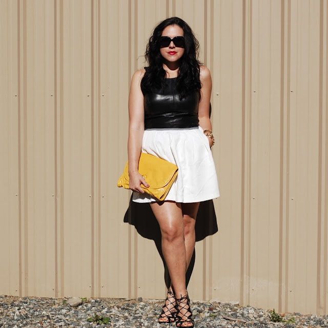 Vancouver fashion blogger,Leather peplum top and white tulip skirt with a yellow Marc by Marc Jacobs clutch.