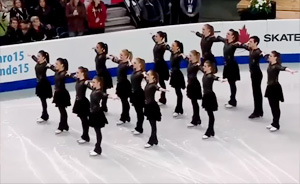 16 Skaters line up in the middle of the rink. When the music starts?