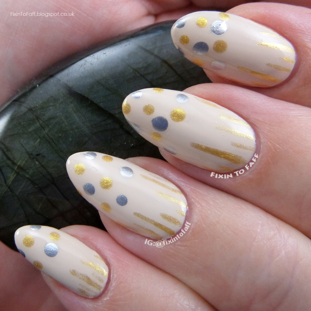 Recreation of Geeky Owl's New Year's Confetti nail art.