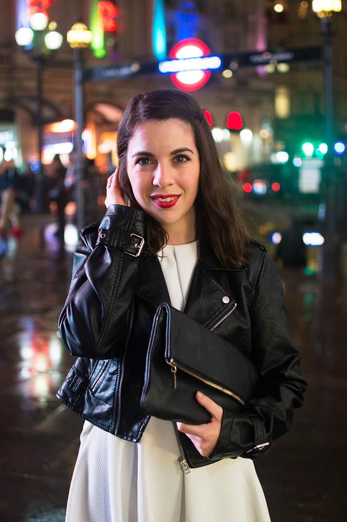 How to wear a black clutch bag in London