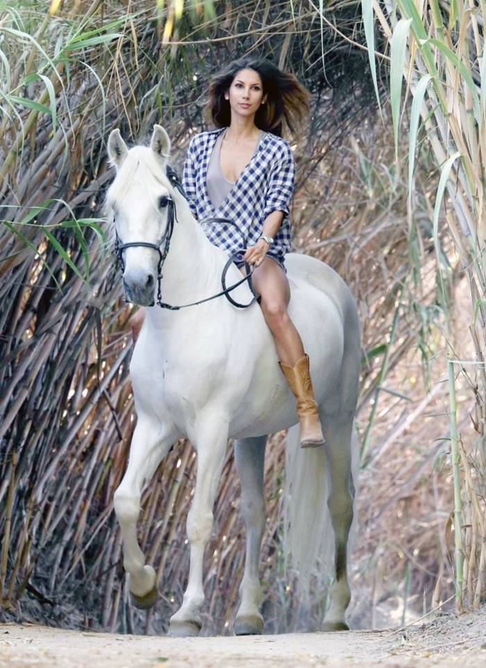 Leilani Dowding Riding a White Horse in Santa Barbara