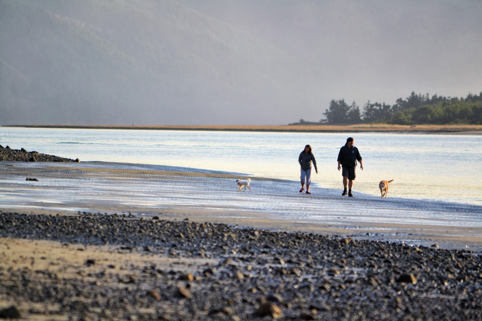Photo of beach walkers at Netarts Bay Oregon by Nancy Zavada