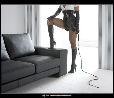 100% Fetish High Heel Boots, Leather Skirt, Corset, Gloves Pantyhose and Whip