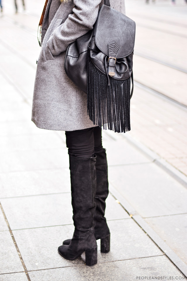What to wear when temperatures dip close to sub-zero - few stylish street fashion inspiration to inspire your daily outfits. Nikolina Vidić, hoe to style grey coat, fringed backpack bad and over the knee boots