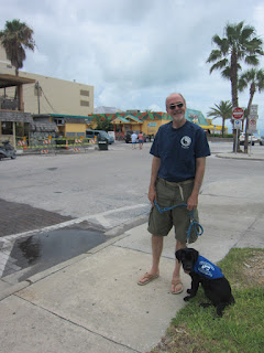Fred and Coach, a black goldadore in front of Frenchy's
