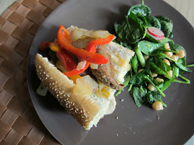 Italian Sausage with Peppers and Onions on a roll with green salad
