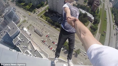 Screencap from the breathtaking footage of a Russian daredevil