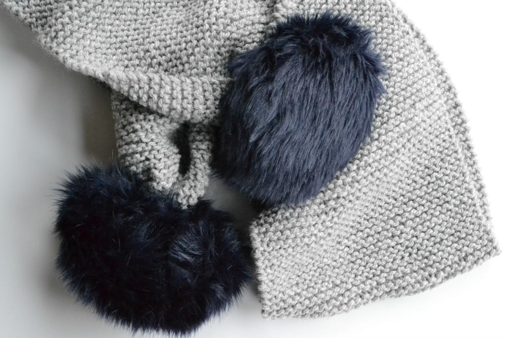 garter stitch knitted grey scarf pompoms faux fur