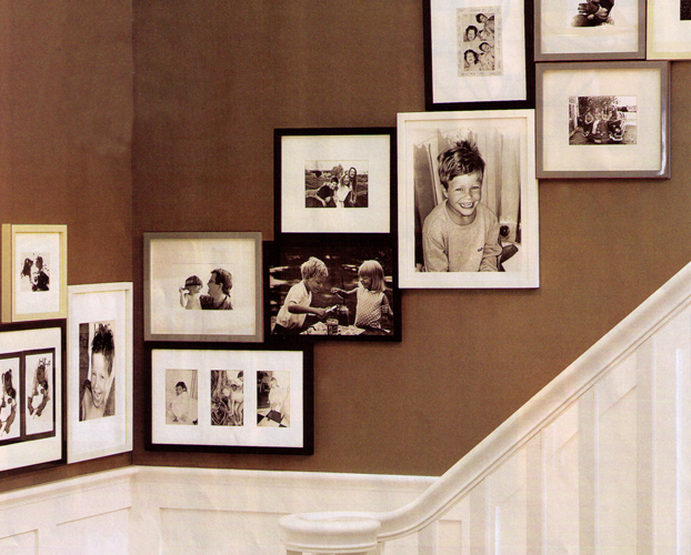 besure designs hanging pictures artwork in a stairway