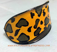 http://koltureshoq.wordpress.com/2013/11/28/turn-your-sunglasses-case-into-a-leopard-print-clutch-bag-awesome-diy/