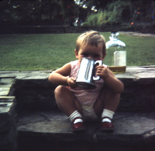 little girl drinking from tankard