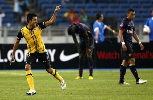 Malaysia XI player Mohamad Azmi Muslim celebrates after scoring against Arsenal