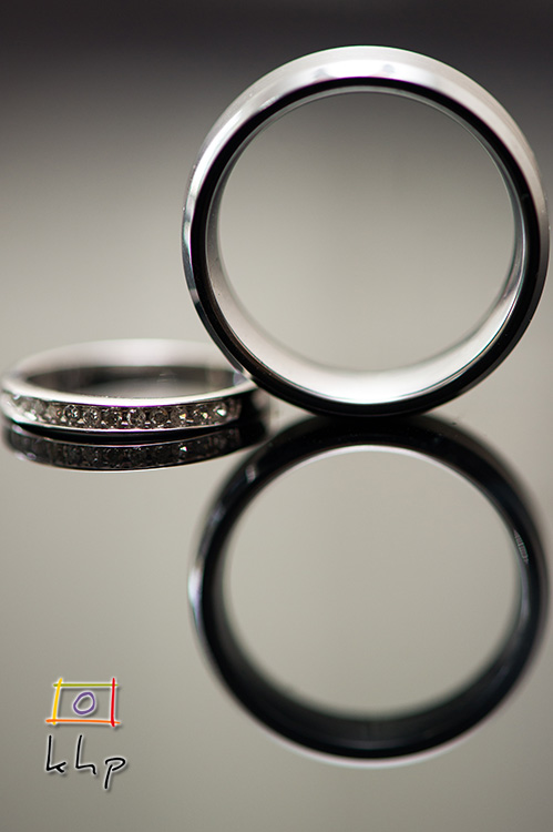 A tightly composed shot of the wedding rings.