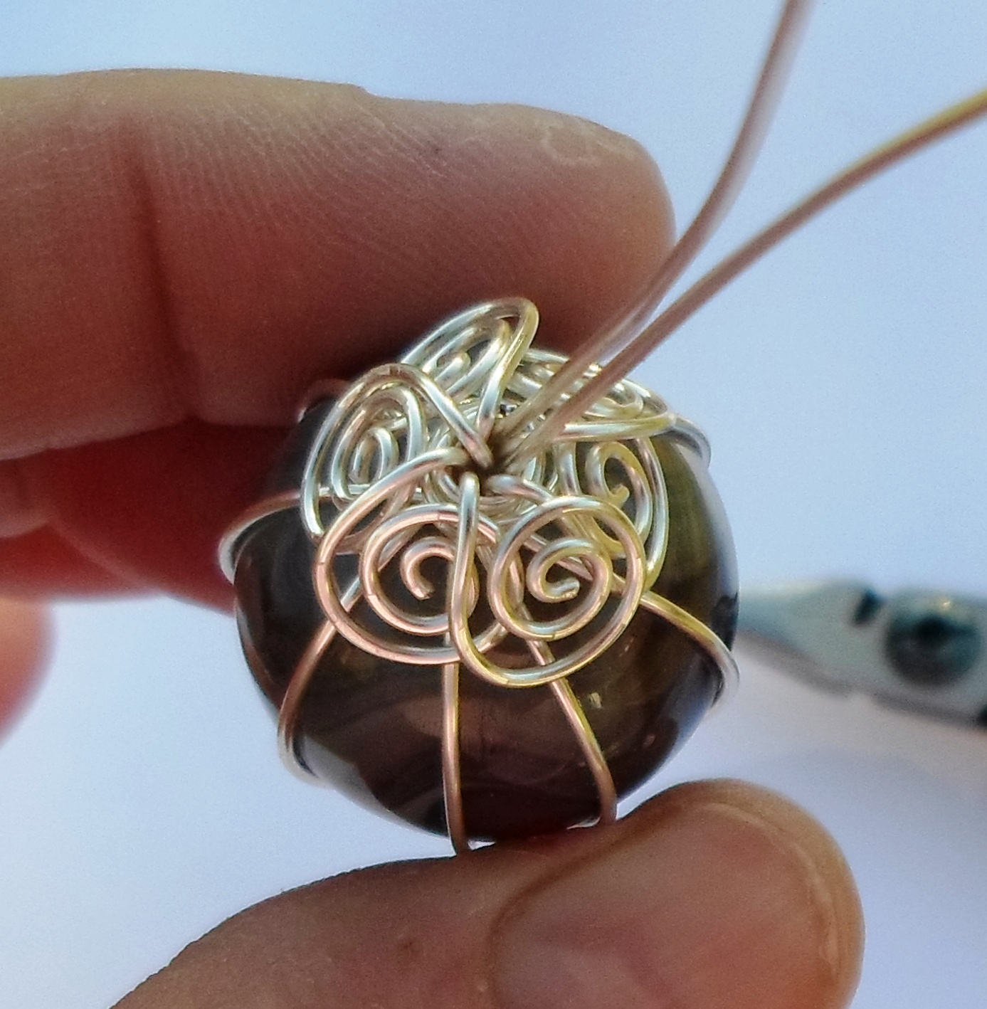 This is a top view of the marble with all 6 open spirals for How to make marble jewelry