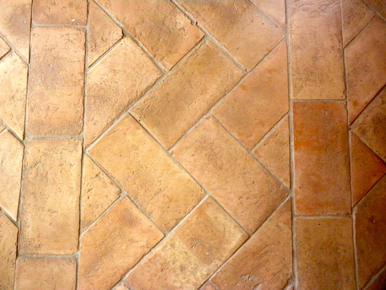 hand made terracotta floor tiles laid in herringbone ( spina reale ...