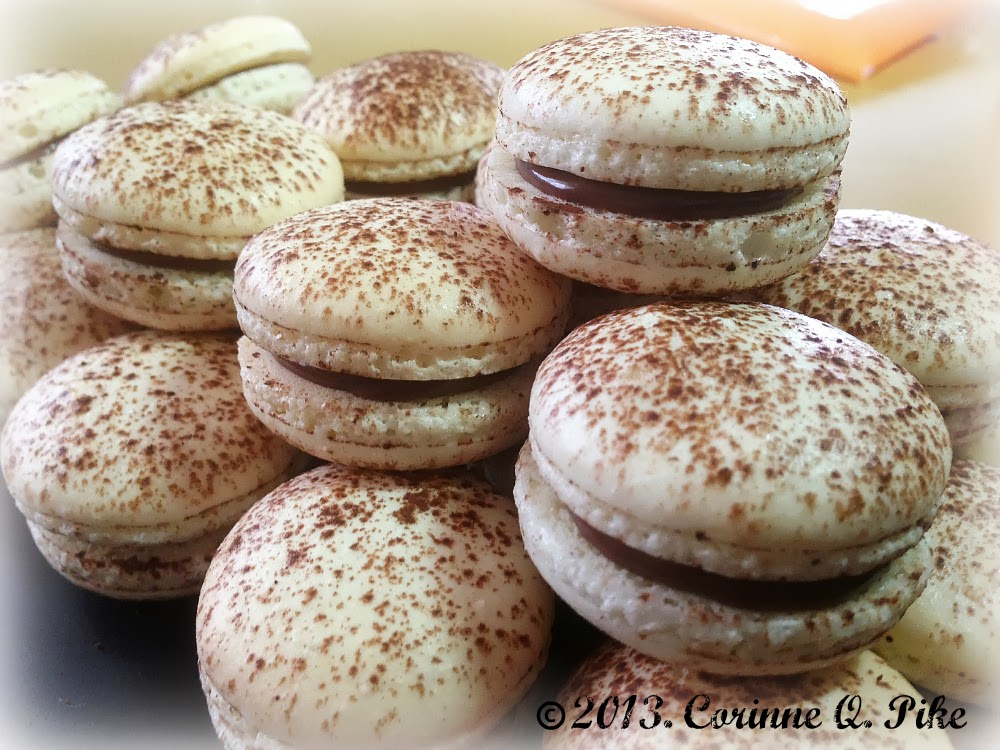 Basic French macarons dusted with cocoa powder and filled with Nutella