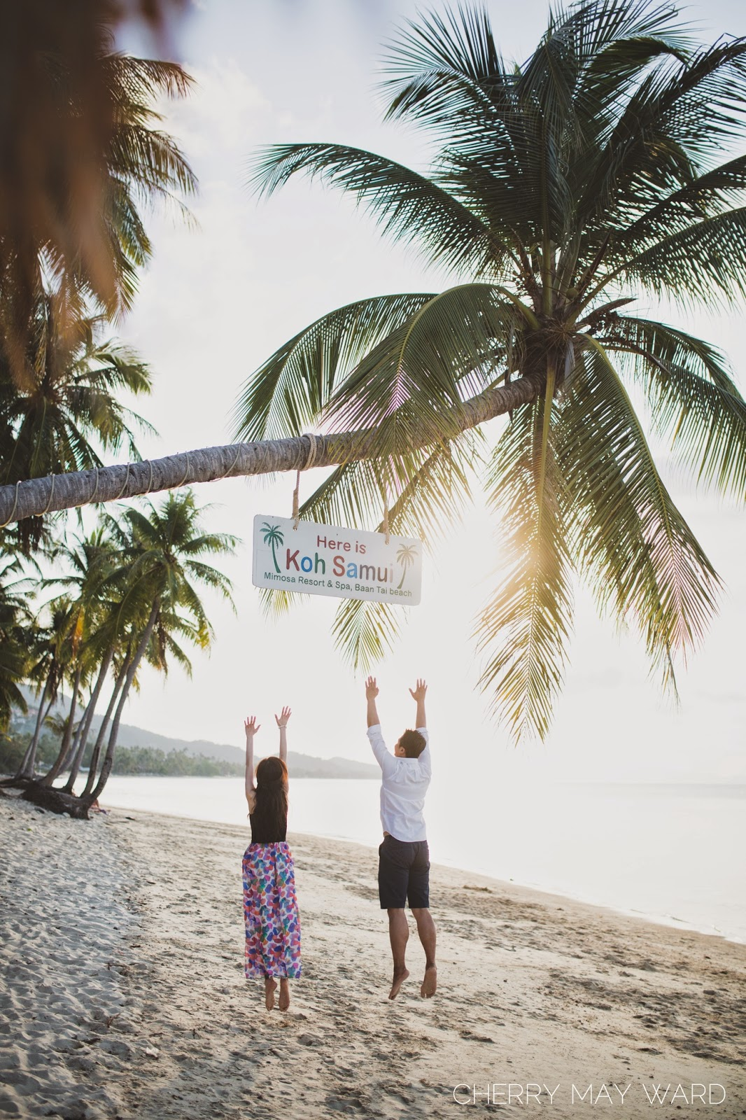 Here is Koh Samui sign, Ban Tai beach, fun engagement photos, couple jumping on the beach, Thailand