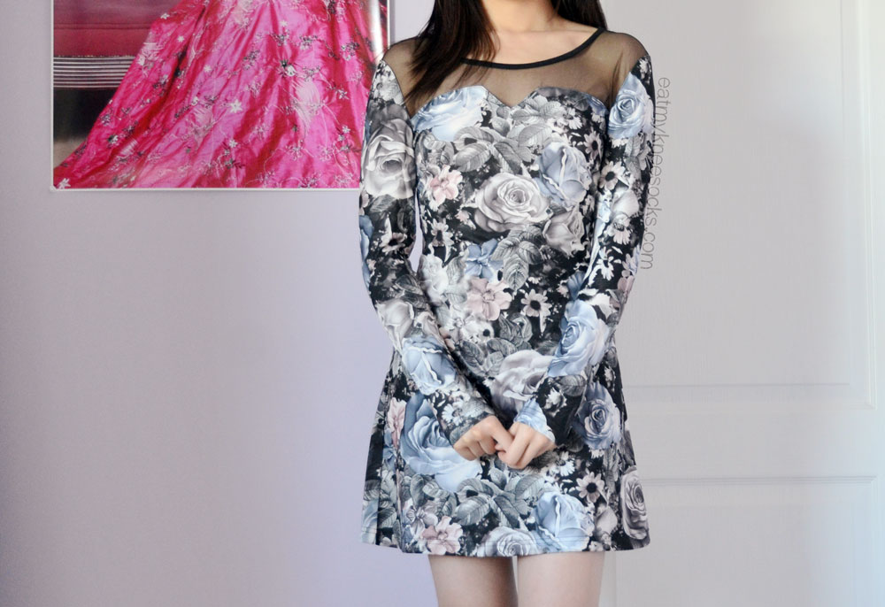 The front of this Romwe rose-print floral dress features mesh paneling at the neckline.