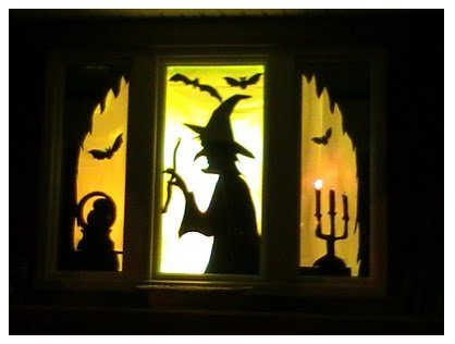 plastic tablecloth cutouts from make it with me - Halloween Window Decor
