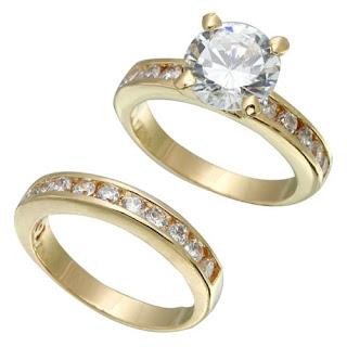 Alianças de casamento: Par com enorme diamante