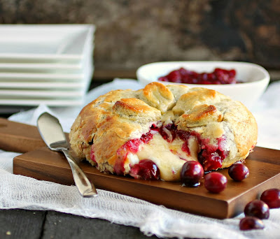 Baked Brie with Herbed Pastry and Rum Cranberry Compote