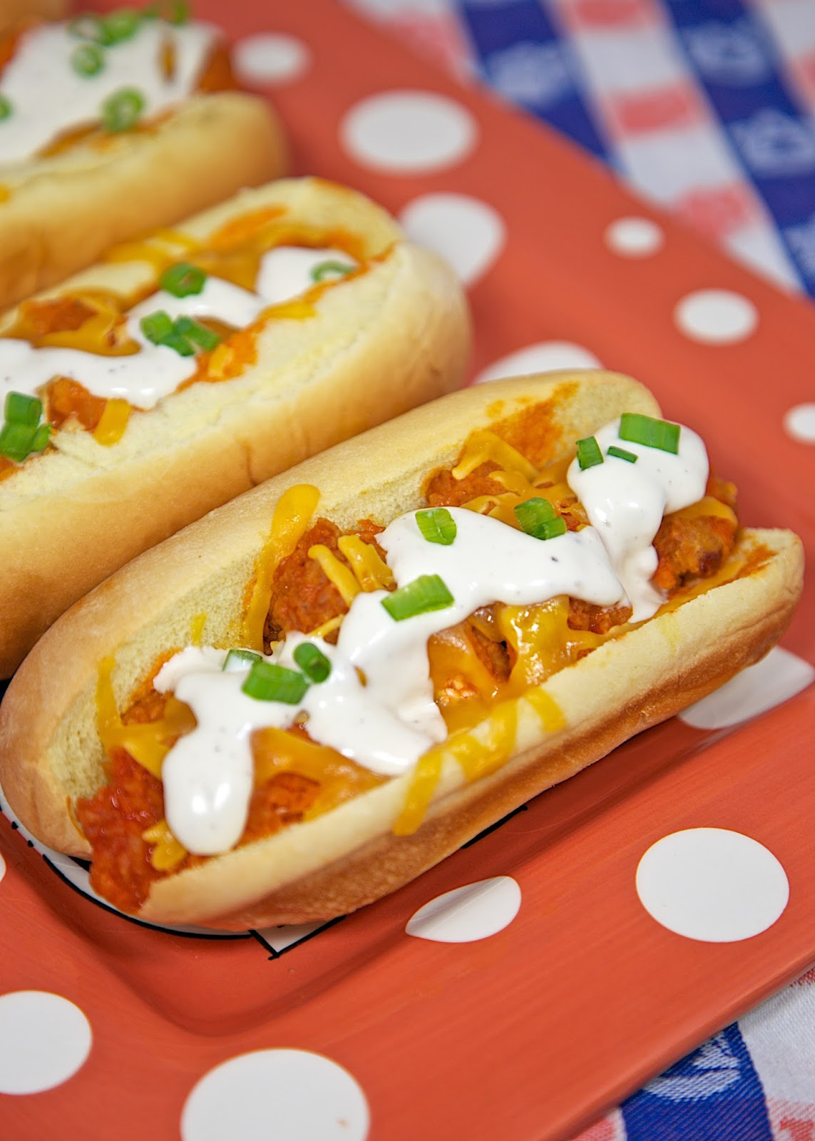 Buffalo Chicken Bird Dogs Recipe - chicken tenders, buffalo sauce, cheese and Ranch served in hot dog buns. Our favorite way to eat chicken tenders!
