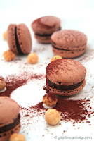 http://giraffescanbake.com/chocolate-and-hazelnut-macarons/