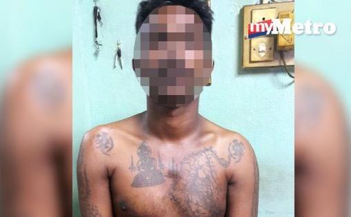 Lelaki berwajah ganas, badan bertatu konsi gelap menangis ditahan polis