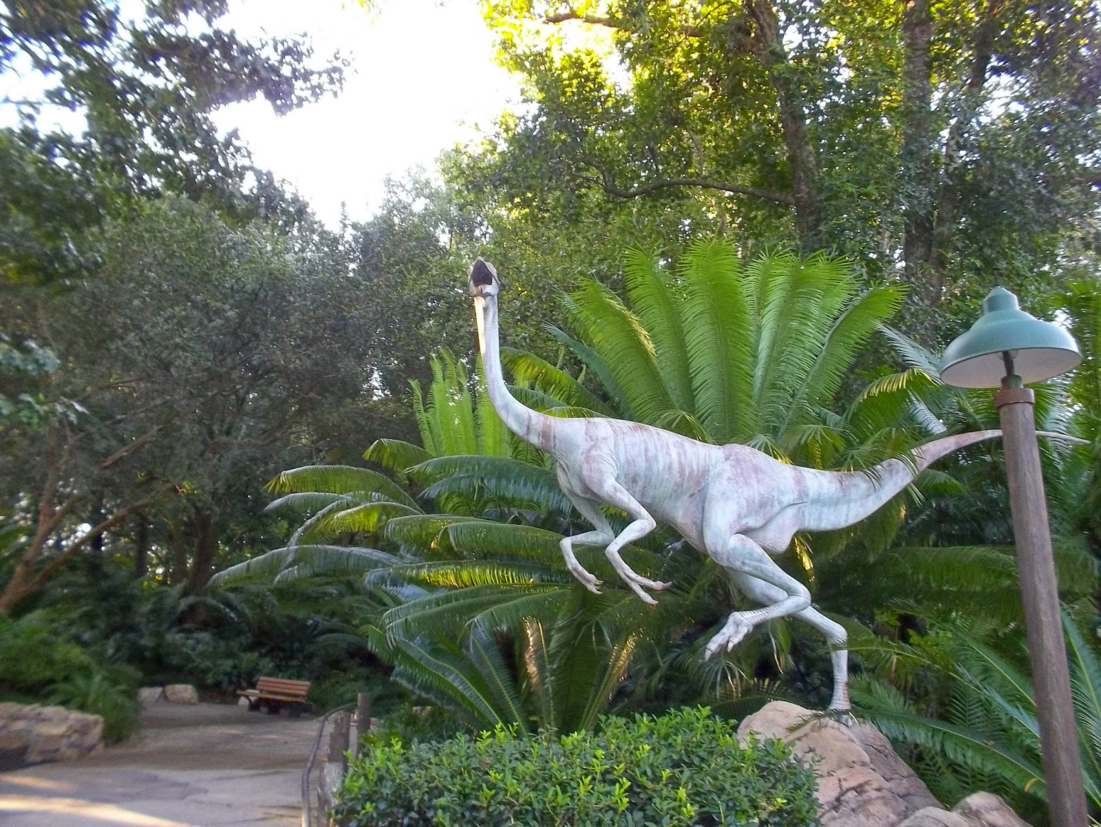 The Entrance Is Protected By A Dino Statue. Behind It Is A Beautiful  Example Of A Cycad, A Plant That Thrived During The Time Of The Dinosaurs  And Still ...