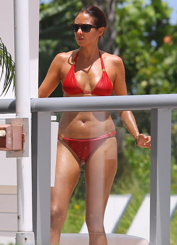 Olga Kurylenko hot in red two piece bikini at a hotel in Miami