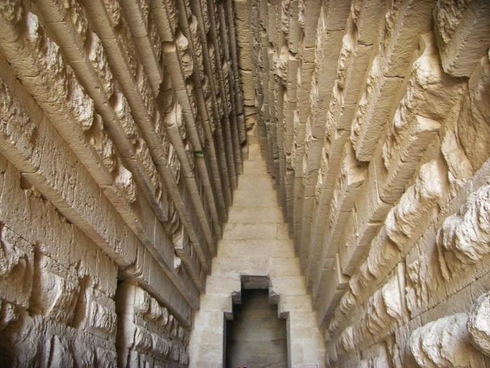 Stepped stone walls of entrance to Royal Kurgan inside ancient tomb