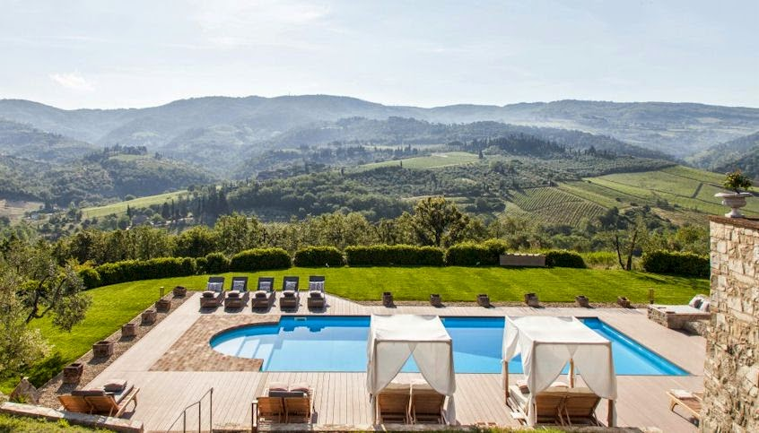 View from Vitigliano Relais and Spa over the swimming pool to the Chianti hills of Tuscany