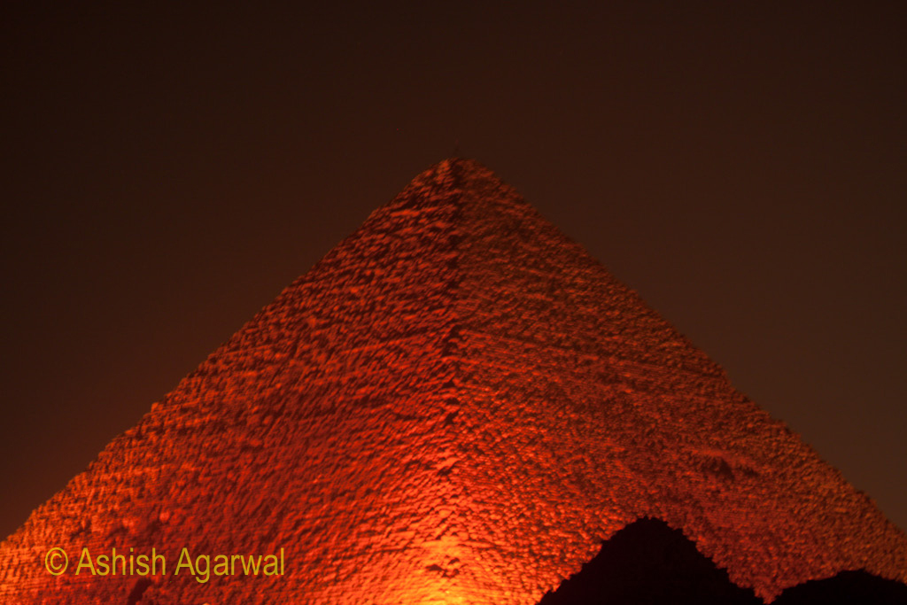 The Great Pyramid, in orange light, during the Sound and Light show, in Giza