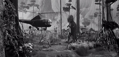 The King of the Dinosaurs attacks the repaired helicopter