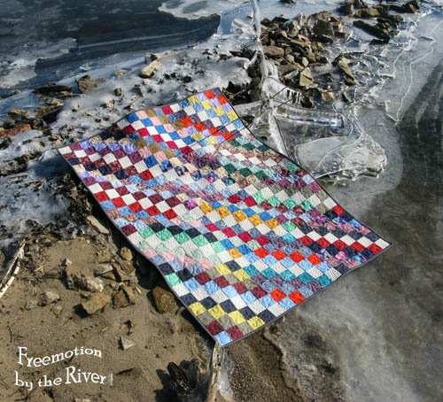 Quilt lying on the shore of the river