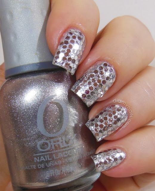 New Year's Eve nails with silver glequins