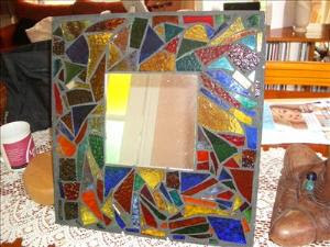 Coloured glass scraps and a mirror