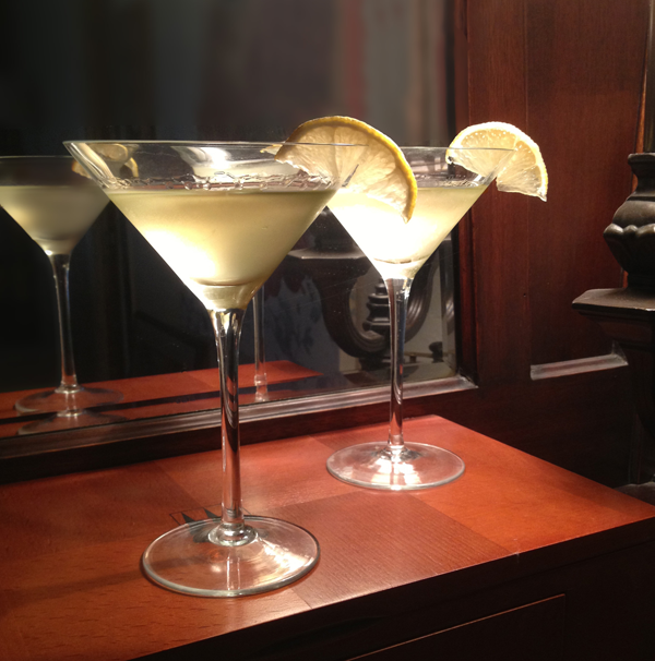 2 Ginger martinis with lemon garnish